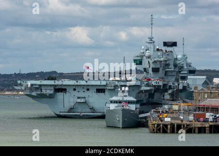 the royal navy aircraft carrier hms queen elizabeth alongside in the dockyard at portsmouth harbour, uk - Stock Photo