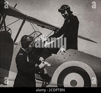 Ms Gabriel Patterson (left) an instructor in conversation with Ms Grace Brown who flew her Tiger Moth into France with medical supplies during the German Advance of 1940. Both were members of the the  Air Transport Auxiliary (ATA)  set up during the Second World War to ferry new, repaired and damaged military aircraft between factories, assembly plants, transatlantic delivery points, maintenance units (MUs) and active service squadrons and airfields. They also flew service personnel on urgent duty from one place to another and performed some air ambulance work.