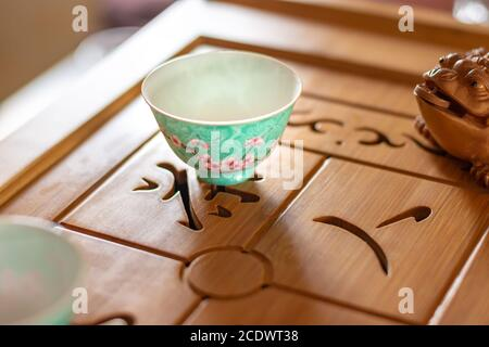 Chinese porcelain tea cup on the table, Chinese tea set image stock - Stock Photo