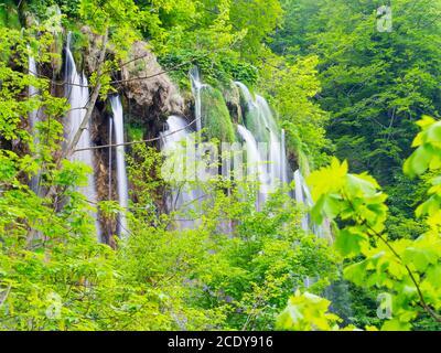 Multiple many several waterfalls in National park Plitvice lakes in Croatia Europe water flowing waterflow waterfall scenic scenery