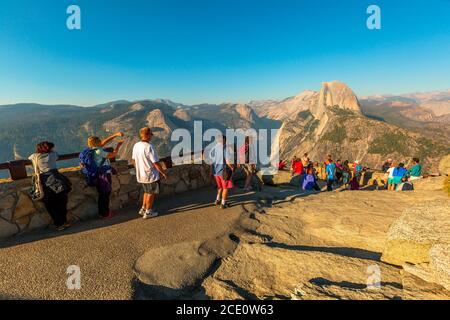 Yosemite, California, United States - July 23, 2019: Glacier Point in Yosemite National Park. tourist View from Glacier Point: Half Dome, Liberty Cap - Stock Photo