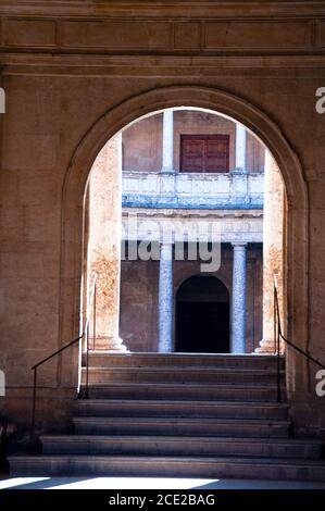 The entrance to the spectacular two story inner courtyard circular patio at Charles V Palace at Alahambra in Granada, Spain. - Stock Photo