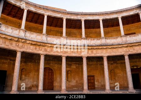 The two story inner courtyard circular patio of two stories at Alhambra palacein Southern Spain, a show stopping renaissance masterpiece. - Stock Photo