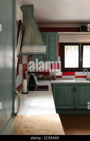 Turquoise and red rustic kitchen