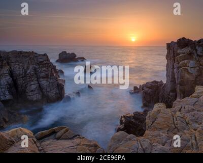 Sunset on the cliffs at Sines. - Stock Photo