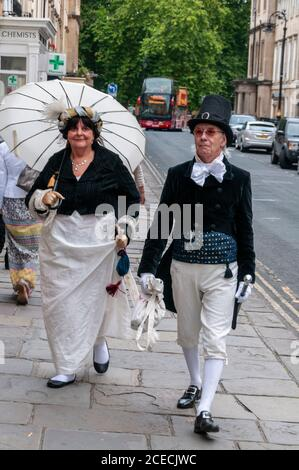 A couple in period dress of Jane Austen's time, taking part in the Jane Austen week in the Roman city of Bath in Britain.  Jane Austin is an English n