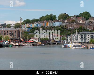 Old and coloured houses seen across Bristol Harbour, Bristol, UK. along with apartments and offices. - Stock Photo