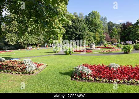 Valley Gardens Harrogate Yorkshire UK - people walking among the colourful flowers in summer; Harrogate Yorkshire England