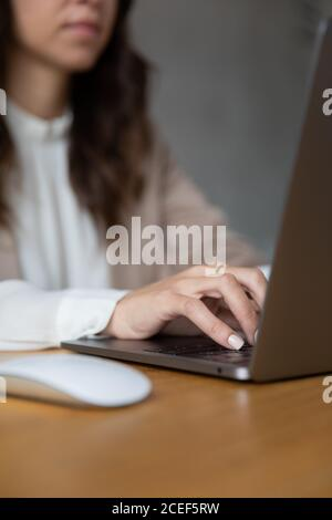 Young girl working with her laptop at home