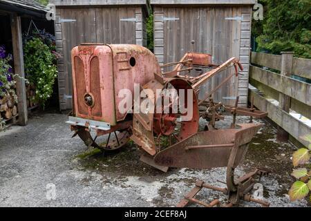Old farm equipment at the Turtley Corn Mill Restaurant, Avonwick, Devon - Stock Photo