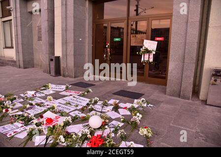Rally against election result and police violence in MINSK, BELARUS - AUG 19, 2020: Flowers and leaflets at Minsk City Executive Committee building. P - Stock Photo