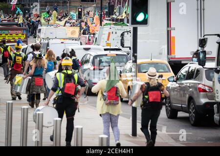 Manchester, UK. 01st Sep, 2020. Extinction Rebellion march through the city, causing traffic to stop during rush-hour. The Northern Rebellion, which is part of the Extinction Rebellion movement, take to the Streets for two weeks of action under the banner of ÔWe Want To LiveÕ. Credit: Andy Barton/Alamy Live News - Stock Photo