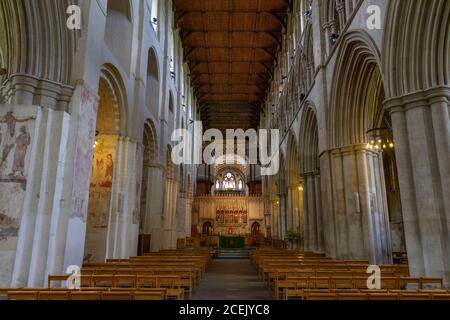 General view down part of the nave towards the nave sanctuary in St Albans Cathedral, St Albans, UK.