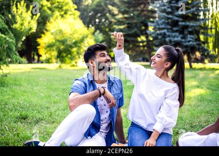 Young couple have fun on picnic in the park.