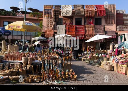 Carpet shop and market stalls in souk  inside the Medina, the old wall city, Marrakesh.