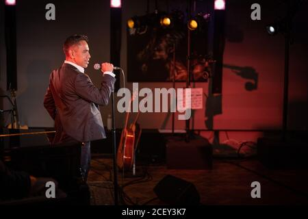 David Bedella performing live at L-Acoustics Creation in London as part of West End Unplugged, an initiative to raise money for various charities supp - Stock Photo