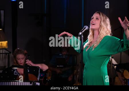 Alice Fearn performing live at L-Acoustics Creation in London as part of West End Unplugged, an initiative to raise money for various charities suppor - Stock Photo