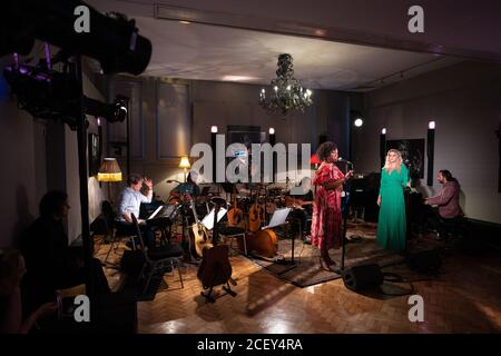 Sandra Marvin (left) and Alice Fearn performing at L-Acoustics Creation in London as part of West End Unplugged, an initiative to raise money for vari - Stock Photo