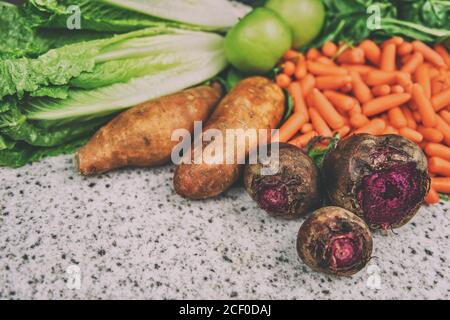 Autumn vegetables beets sweet potatoes background - Stock Photo