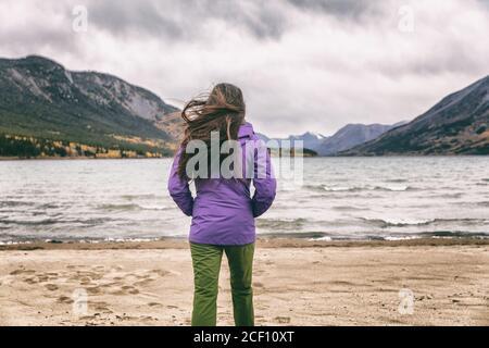 Yukon travel tourist woman walking on beach in Carcross, YUKON, Canada.