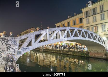 MILANO, ITALY - SEPTEMBER 2015: Tourists and locals enjoy night life along Navigli. Stock Photo