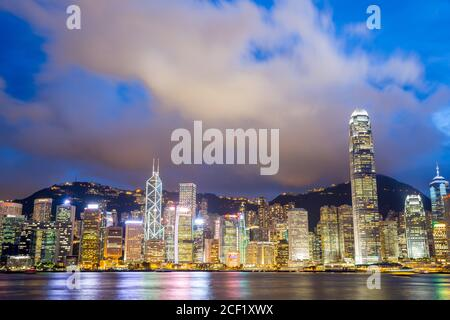 Hong Kong Skyline from Victoria Harbour at dusk. - Stock Photo