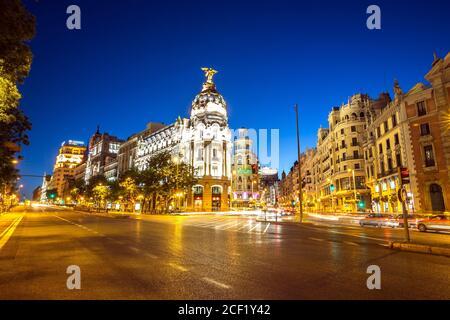 Gran Via, main shopping street in Madrid, Spain at dusk. - Stock Photo