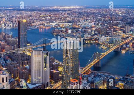 Aerial view of Brooklyn bridge and Manhattan bridge with Brooklyn cityscape skyscrapers bulding from Lower Manhattan in New York City New York State Stock Photo