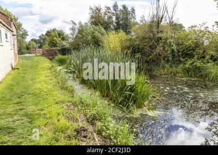 The Thames and Severn Way long distance footpath beside the disused Stroudwater Navigation at Saul Bridge, Upper Framilode, Gloucestershire UK - Stock Photo