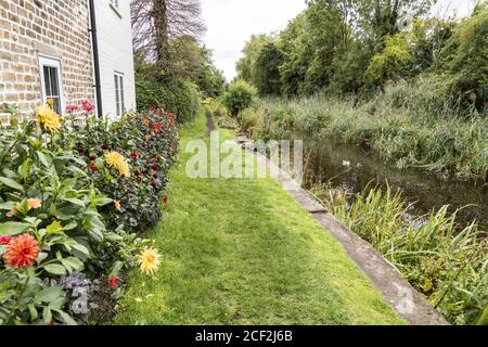 The Thames and Severn Way long distance footpath beside the disused Stroudwater Navigation near the Ship Inn, Upper Framilode, Gloucestershire UK - Stock Photo