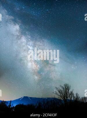 Wild landscape under bright night sky with Milky way - Stock Photo