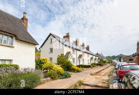 A row of pretty roadside cottages at Otterton, a picturesque quaint small village in the Otter Valley in East Devon, south-west England