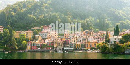 Panorama of Morning View on Colorful Town Varenna on Lake Como in Italy. Bright Architecture with Yellow Buildings.