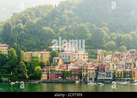 Morning View on Colorful Town Varenna on Lake Como in Italy. Bright Architecture with Yellow Buildings.