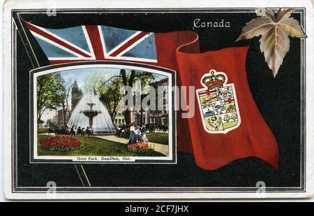 The postcard features a black background with an inset image of the Gore Park fountain ontop of the Canadian Red Ensign with the Hamilton emblem. A maple leaf is situated in the top right corner.  The postcard is addressed to [Miss] J. Smith, 77 St. Joseph St, Toronto, [F.A.T.]. The verso has a 1 cent green Canadian stamp with wavy cancellation marks. The return stamp is dated September 26, 1909, 12 PM, Hamilton. The number S B 2261 is printed on the verso. The postcard corners are slightly bent.  Postcard Collection HPL_PC_s18_71r_32022206615649 - Stock Photo