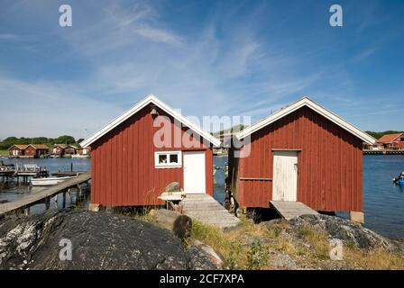 Fishing huts in South Koster Island (in the background North Koster Island), Sweden - Stock Photo