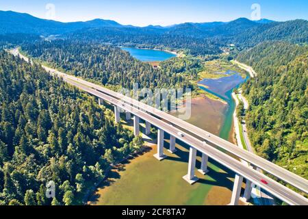Viaduct Bajer above Bajer lake aerial view, Scenic highway A6 in Gorski Kotar region of Croatia, - Stock Photo