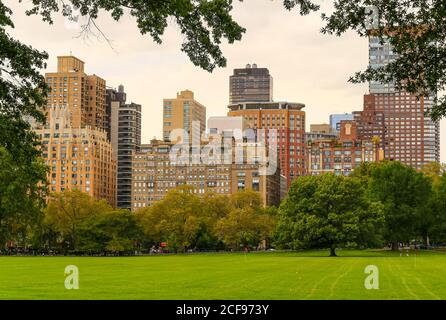 New York City, USA - October 7, 2019: View across the Sheep Meadow in Central Park to the skyline of adjacent buildings near Lincoln Square.