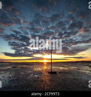 Summer sunset looking across the Pilgrim's Causeway on The Holy Island of Lindisfarne, Northumberland, England, United Kingdom - Stock Photo