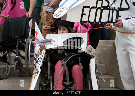 London, UK. 4th September, 2020. A girl in a wheelchair leads the anti-hs2 trains at day five of Extinction Rebellion's 10 day protest. Protests are occurring internationally. Protest's in England are focussed on getting MPs to back the Climate and Ecological Emergency Bill and against HS2. Credit: Liam Asman/Alamy Live News