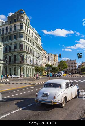 Street in front of Capitol building with white vintage car, Old Havana, Cuba