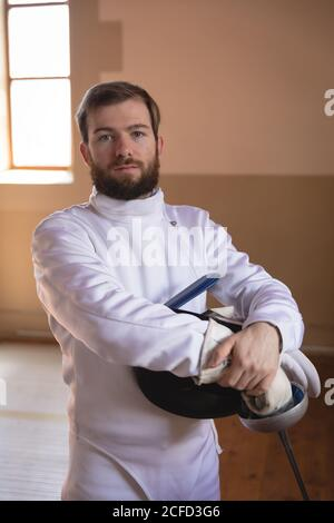 Man wearing fencing outfit