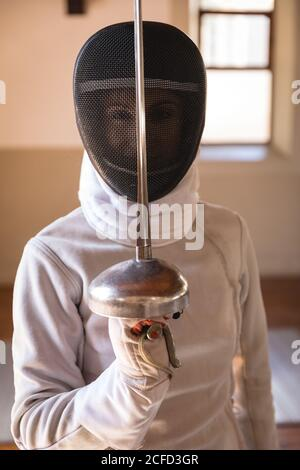 Woman wearing fencing outfit