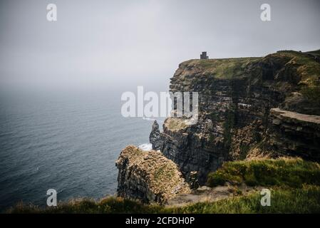Cliffs of Moher in Ireland: View north with the O'Brien's Tower - Stock Photo
