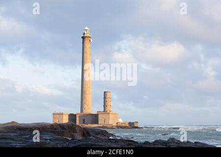 The Gatteville lighthouse in Normandy is one of the largest of its kind in the world. Taken during a winter storm at sunrise - Stock Photo