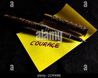 Courage word displayed on paper slip concept for educational informative awareness.