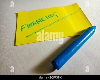 Financing word displayed on paper slip concept for educational informative awareness.