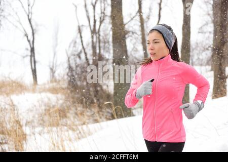 Winter jogging - woman runner running in cold air