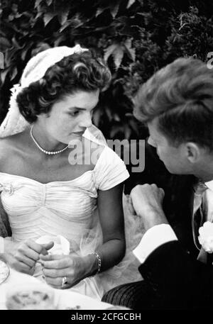 The wedding of Senator John F Kennedy to Jacqueline Bouvier in Newport, RI on September 12, 1953. The couple talking at their wedding reception. - Stock Photo