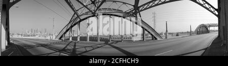Los Angeles, California, USA - August 2002:  Black and white archival stitched panoramic view on the old 6th Street bridge over the LA river.  Bridge was demolished in 2018. - Stock Photo